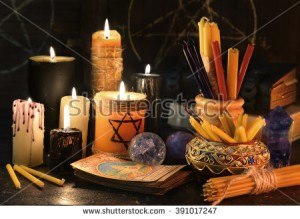 stock-photo-still-life-with-evil-candles-witch-books-and-the-tarot-cards-fortune-telling-seance-or-black-391017247